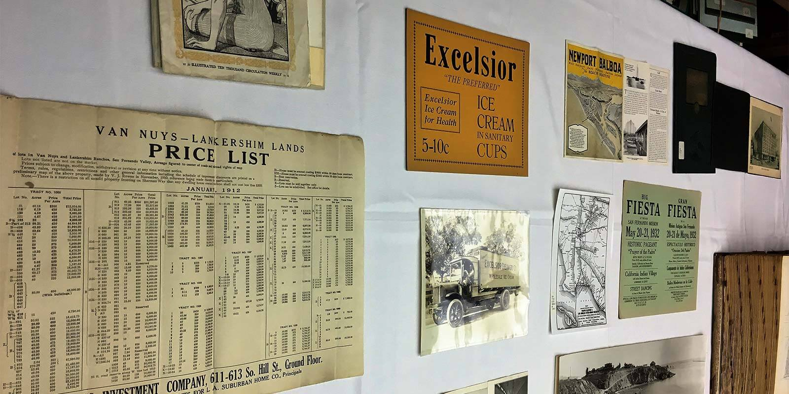 historical documents hanging on library wall